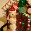 detail for gingerbread house, snowman from Raffaelo coconut candy from Ferraro